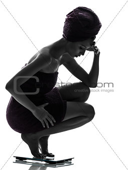 beautiful asian young woman worried on weight scale silhouette