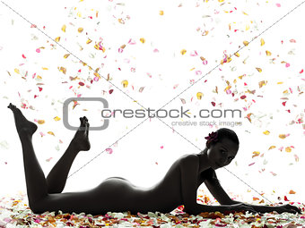 beautiful asian woman naked lying with flowers petal silhouette
