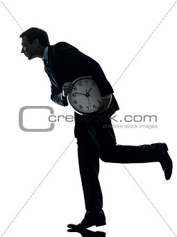 business man holding clock robbing time  silhouette