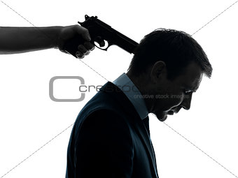 business man with gun pointing to his head  silhouette