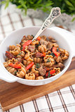 Pasta with meat and vegetables on wooden board