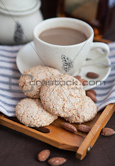 Almond cookies on a tray on the background of coffee cup