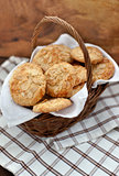Oatmeal cookies with almond in a basket on a wooden background