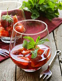 strawberry dessert in a glass - berries in syrup