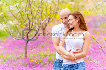 Lovers hugging outdoors