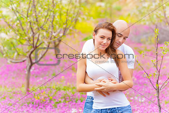 Happy couple in spring park