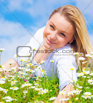 Attractive girl on daisy glade