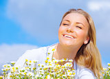 Young woman enjoying daisy field
