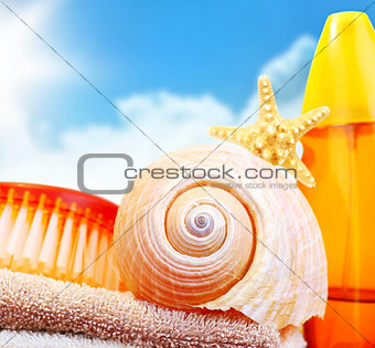 Beach items over blue sky