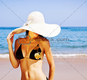 Stylish girl on the beach