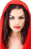 Young woman in red hood with red lips
