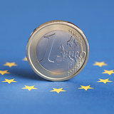 One Euro coin on the EU flag