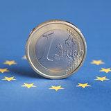 One Euro coin on the EU flag