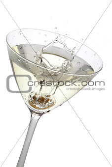 Olive splashing into a cocktail glass, isolated