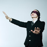 blindfold business woman
