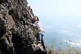 Woman climbing rock