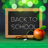 Back to school, written on blackboard with chalk,