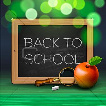 Back to school, written on blackboard with chalk,
