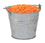 Red lentils in a miniature metal bucket