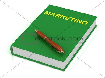 Green book on marketing and brown pen