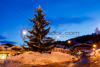 Illuminated Christmas Tree in th Village of Megeve, French Alps,