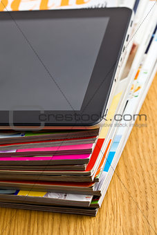 touch tablet and magazines