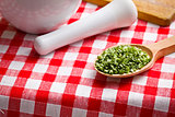 €‹green chives in wooden spoon