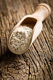 wholemeal flour in wooden scoop