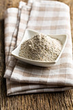 wholemeal flour in ceramic bowl