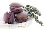 Lavender macaroons on linen napkin. 