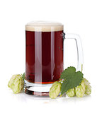 Dark beer mug and hop branch