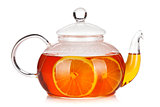 Glass teapot of black tea with lemon
