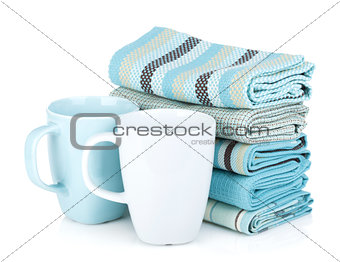 Kitchen towels and tea cups