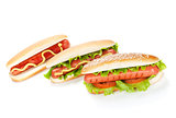 Three hot dogs with various ingredients