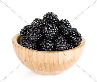 Blackberry in wooden bowl