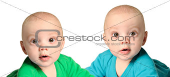 Twin baby boys in blue and green