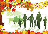 Autumnal park with families
