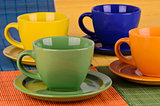 A set of colorful cups with plates