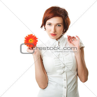 Beautiful woman with flower gerbera in her hands against white b