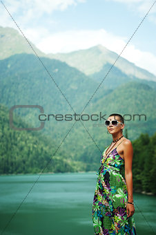 girl in mountains on the lake