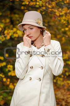 attractive woman in evening autumn park