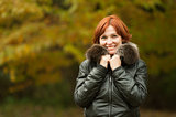 young woman portrait in autumn park 