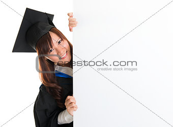 Graduate student hiding behind blank placard