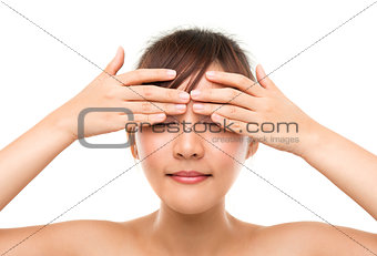 Skincare woman putting eye cream