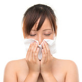 Flu or cold - sneezing woman sick blowing nose. 