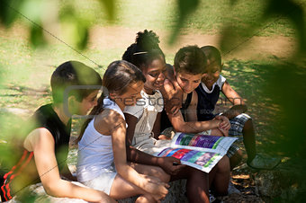 Children and education, kids and girls reading book in park