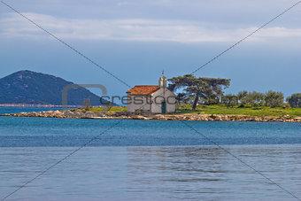 Church on small island coast