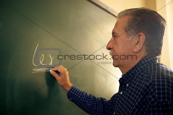 People and education, law teacher writing on blackboard in colle