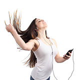 Beautiful woman dancing and listening to the music with headphones