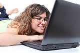 Beautiful woman lying and browsing in a laptop